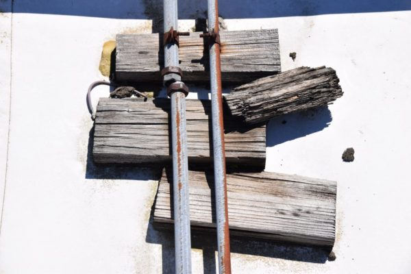 Rotting Wood pipe supports